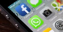 Facebook buys out mobile messaging service WhatsApp