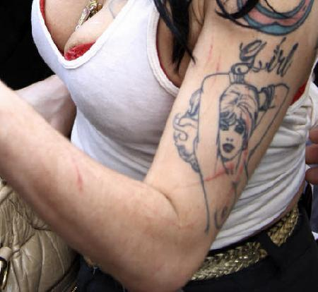 Amy Winehouse - tattoos and scratches · >. Photo 7 of 11. Boobs strike back