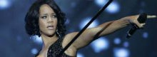 Rihanna told off for touching lapdancers