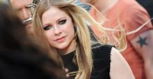 Avril Lavigne marries Chad Kroeger wearing a black wedding gown