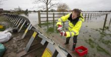 UK floods 2014: Environment Agency job cuts 'on hold'