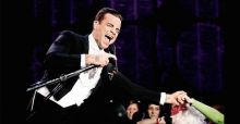 Robbie Williams falls from stage in Newcastle and breaks screaming fan's arm - VIDEO