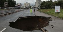 Massive hole appears in middle of busy Manchester Road