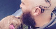 Loving dad gets tattoo of cochlear implant to match his daughter