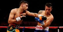 Amir Khan survives knockdown to grab points victory