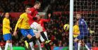 Rooney double keeps United on track for title